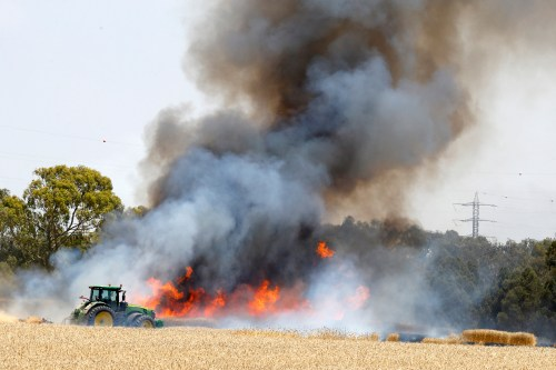 Israeli wheat and hay fields set ablaze along the Gaza border fence