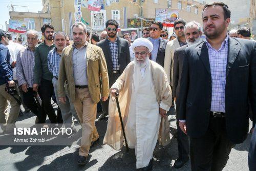 Ayatollah Ahmad Jannati marching