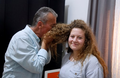 Ahed Tamimi's father, Bassem, kissing her hair