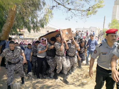 The funeral of a member of the Jordanian security forces after the Salt explosion