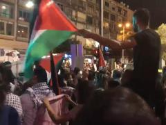 Palestinian flags waved at Tel Aviv demonstration on August 11, 2018.