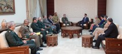 The Iranian defense minister in a meeting with Bashar Assad