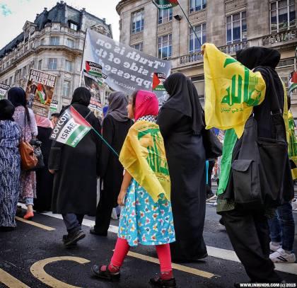 A child wears a Hizbullah flag