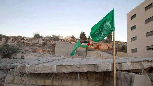 A Hamas flag flies over a Hamed clan house in Silwad