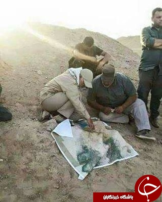 Soleimani (left) on a visit to one of the battlefronts in Iraq