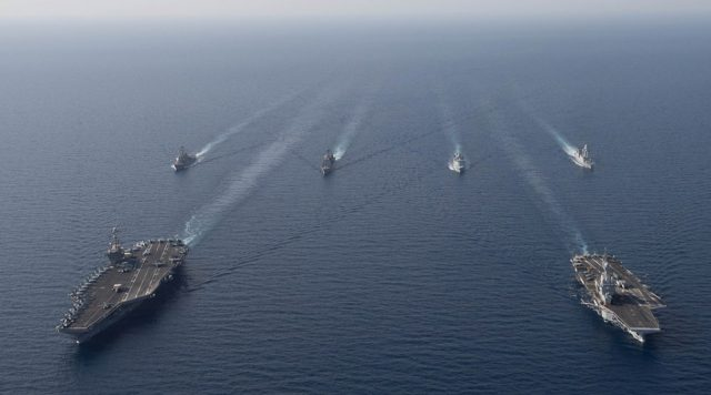The Charles de Gaulle Carrier Strike Group and the John C. Stennis Carrier Strike Group conduct operations at sea