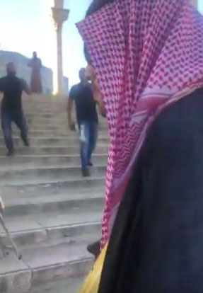 Waqf guards descending from the Dome of the Rock