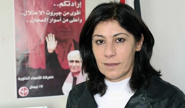 Khalida Jarrar posing with PFLP poster