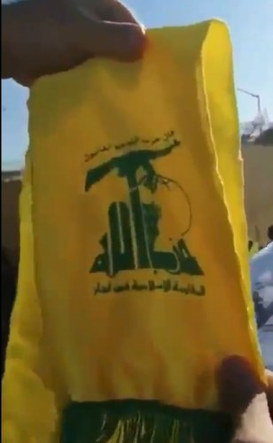 Hizbullah banner seen at the Baghdad riots
