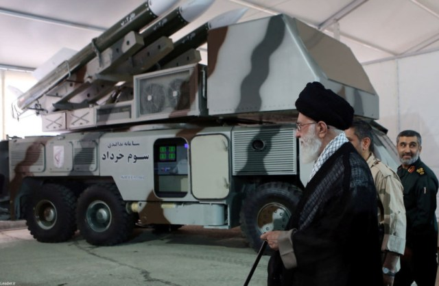 Ali Khamenei observing a weapons system
