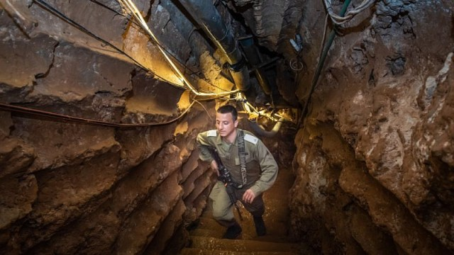 An Israeli officer explores a Hizbullah tunnel into Israeli territory