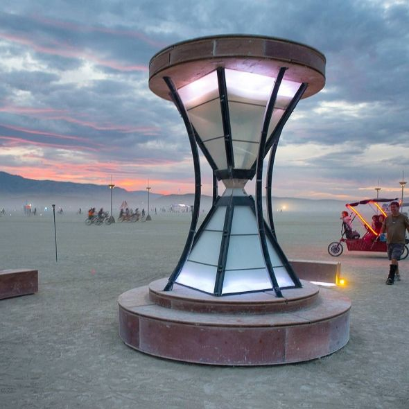 Chronosydra is a huge reverse hourglass that displays the passage of time on the Playa