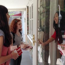 Or Tzedek canvassed with Raise Illinois, an advocacy campaign dedicated to raising awareness and fostering political activism to lift wages for low-income workers and families. Rena and Emily ask a voter to sign a pledge form, reminding her to vote on November 4.