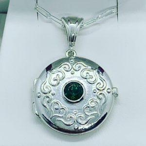 Pendant -Scrolled Locket with bezel set Emerald