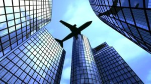 airplane-flying-above-office-buildings