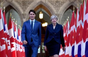 Prime Minister Justin Trudeau and British Prime Minister Theresa May walk in the Hall of Honour on Parliament Hill in Ottawa during a visit on Monday, Sept. 18, 2017. THE CANADIAN PRESS/Justin Tang