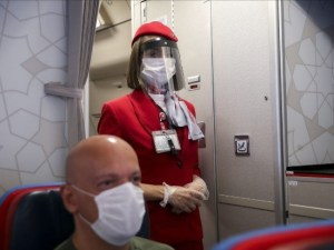 flight attendant with PPE