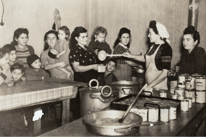 Jewish refugees getting food at a JDC displaced persons camp after World World II.