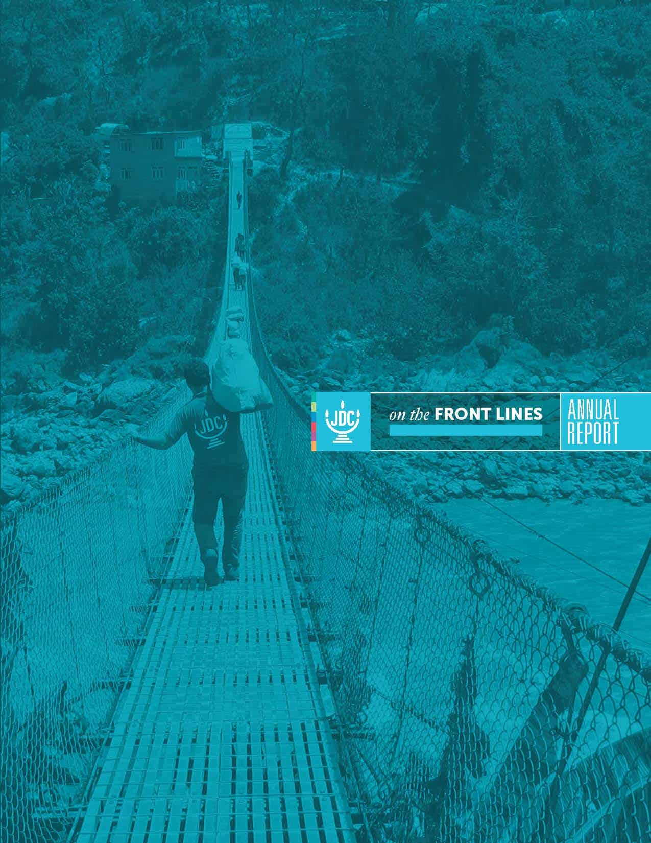 JDC's Annual Report 2016 in which a JDC humanitarian aid worker carries aid across a rope-bridge.