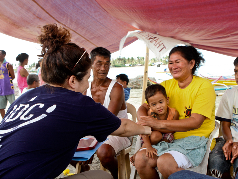A JDC humanitarian aid worker in the Phillipines meeting with family in the aftermath of Typhoon Haiyan.