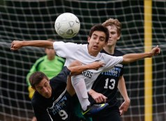 Eastern Randolph's Roberto Diaz and Trinity's Dylan Phillips fight for possession of the ball at Eastern Randolph High School