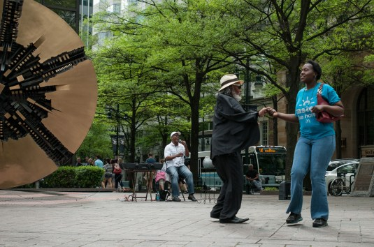 A couple dance to live music on a Saturday afternoon in Uptown Charlotte, NC.