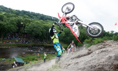 Jason Feldman gets his bike airborne during his first ride in the 250 class at the hill climb near Fordville, ND on Saturday, July 2, 2016. (Joshua Komer/Grand Forks Herald)