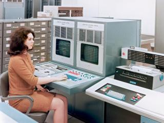01 Jan 1966, Houston, Texas, USA --- Sandy McGee at the Laboratory Universal Control computerized lab controls using IBM equipment --- Image by © Pete Vazquez/Science Faction/Corbis