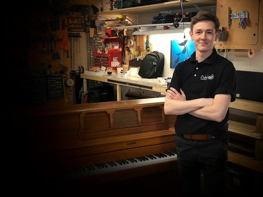 James Dowbiggin, piano tuner and technician, in his piano workshop where he repairs and tunes clients' instruments.