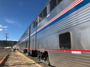 Rail journey on Amtrak and conductor ready to board