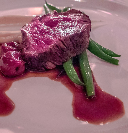Bison with cherries and beans