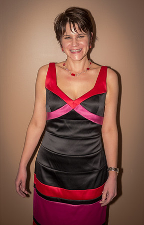 Wearing black, red, and pink dress