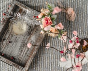 flowers next to wooden tray