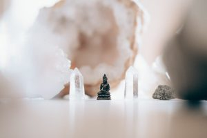 Small Buddha surrounded by white crystals.