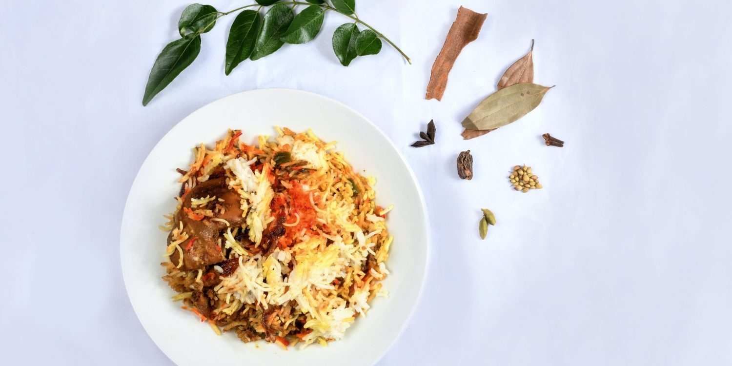 biryani on a white plate with a white background