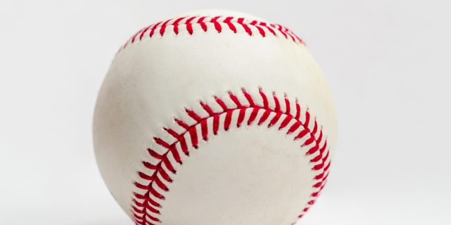 A baseball close up with a white back ground.
