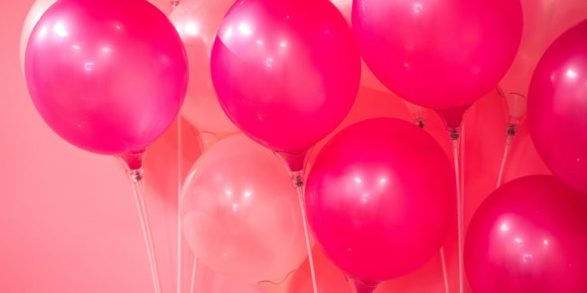 Different shades of pink balloons on a pink back ground.