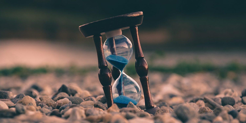 Traditional hourglass on rocks.