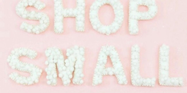 shop small written in white letters on a pink background