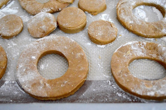 I used my donut cutter to cut out perfect little apple cider donuts and donut holes! I laid them all out on another well floured sheet tray and chilled them for another 10 minutes.