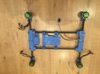 Frame with motors, one ESC and the Raspberry Pi mount with vibration dampers