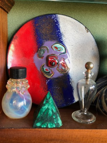 Perfume bottles, and a ceramic plate