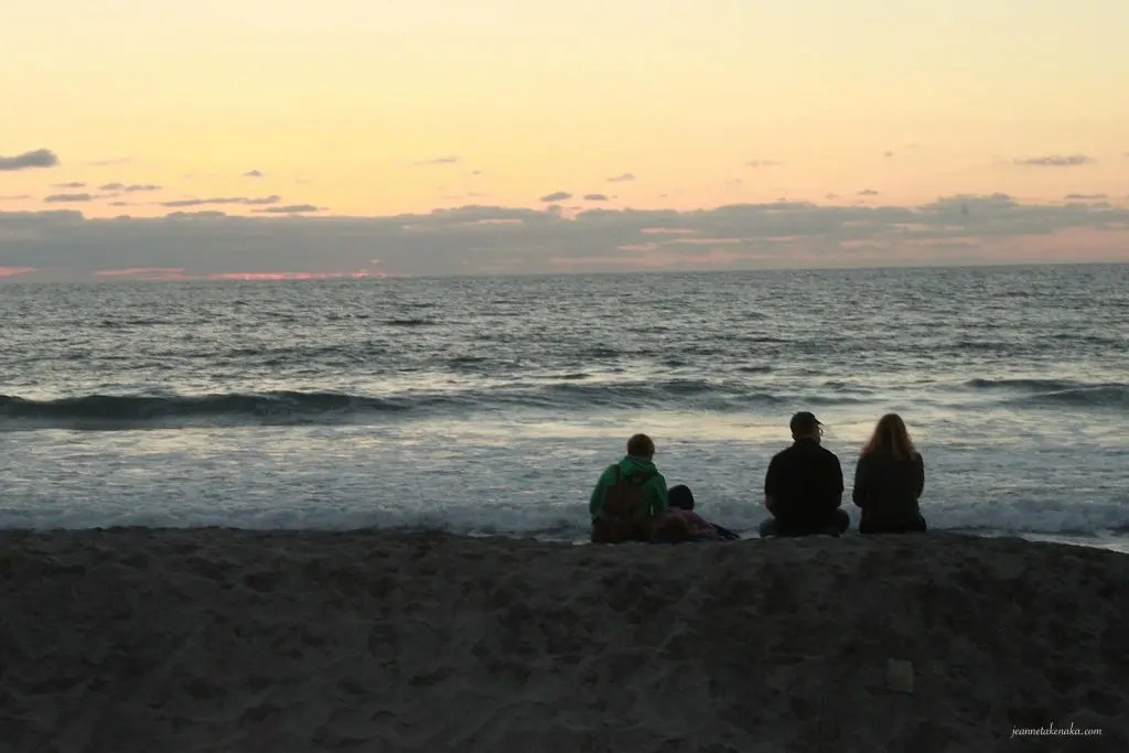 Fulfillment in relationships-people sitting together on the beach