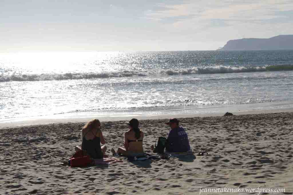 A lifestyle of rest: three friends sitting at the beach
