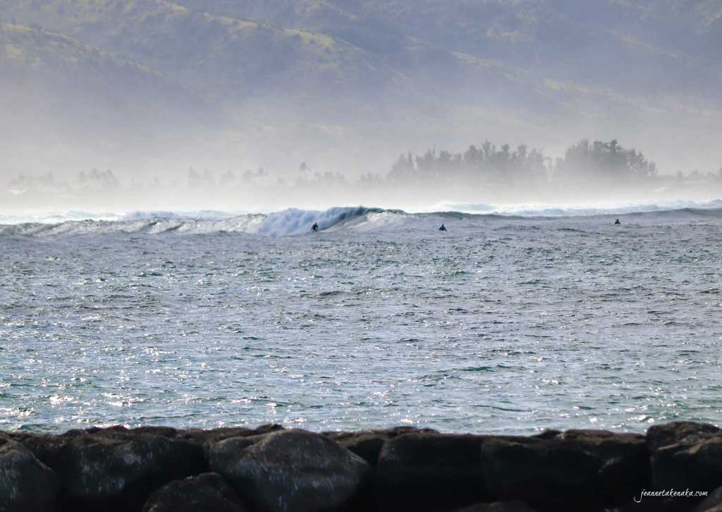Surfers waiting for the right big wave to ride . . . symbolic of how when we wait, we need to maintain a healthy mindset