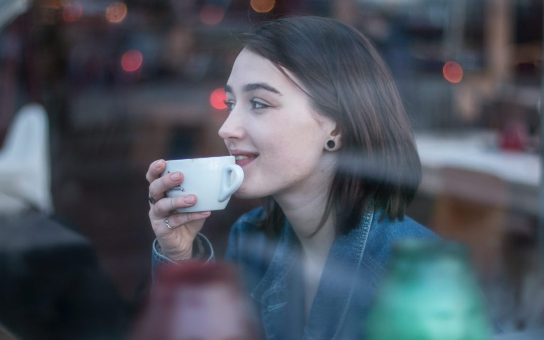 girl at peace after considering ways to remove fear in her life coffee cup in hand