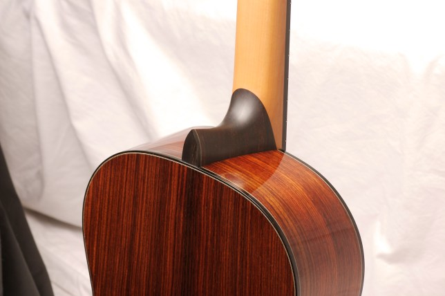 Traditional classical guitar with ebony heel and bindings, steamed pear wood neck