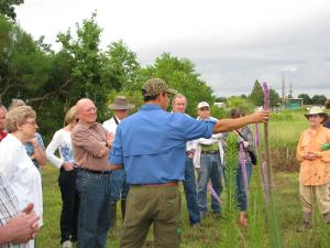 Bayou Land Conservancy Jamie Gonzalez conducts a tour through the Deer Park Prairie. The group has until midnight Tuesday to raise the final $500,000 to save this historical, living treasure.