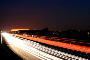 Cars speeding on highway at night