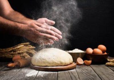 Baker cooking bread. iStock